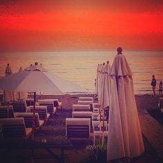 "On the beach in the spain with sun beds and parasols. ""Spanish #sunset #allthefilters"""