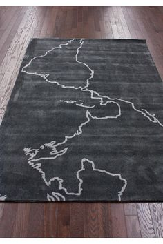 Map Rug - this inspires me to buy an inexpensive IKEA rug and let the girl child trace outlines of the continents, in fabric paint.