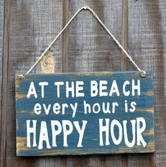 """At the Beach every hour is Happy Hour"" sign"
