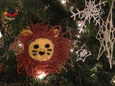 Yarn bombed Christmas tree - lion amigurumi