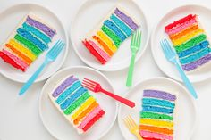 rainbow layer cake slices cut to see rainbow center