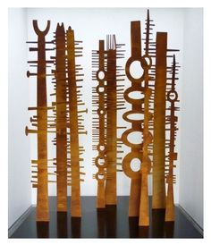 Bush-fired Tree totem sculptures in rust or blackened rust finish by Peter Mclisky.
