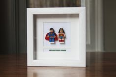 "Superheroes Lego Mini Figures Superman & Wonderwoman Framed - ""The Kryptonite Couple"". £35.00, via Etsy."