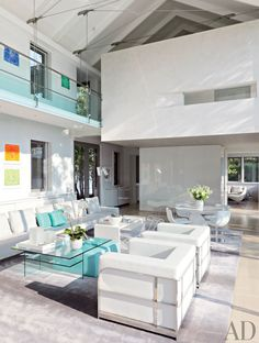 Sleek white sofas make bold statements in these brilliantly designed living rooms