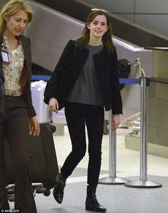 A jet-lagged Emma Watson gets photo bombed by goofy fan at LAX Sunday