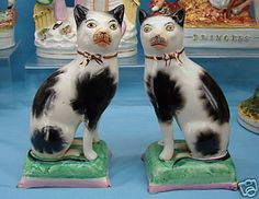 Pair of Staffordshire cats. 19th Century.