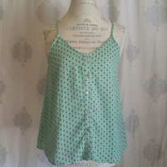 Floral polka dot tank This cute, lightweight tank is perfect for spring and summer. Buttons up the front, V straps in the back. Worn a few times, EUC. Offers welcome using the Offer button. No trades. CALS Tops Tank Tops