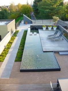 I like the steel frame around the slightly raised water feature, with the wood deck overlay
