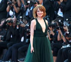"""Emma Stone looking fabulous rocking a new """"do"""" on the red carpet at the Venice Film Festival for the premiere of Birdman - Venice, Italy Aug 27 2014"""
