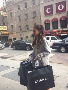 Chanel shopping; in a sweatshirt
