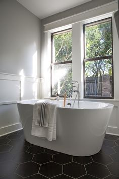 We took out the existing built-in tub and installed a freestanding tub to make the room feel more spacious.