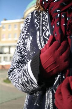 Mixing interesting patterns and textures to create an unusual look. Jacquard print medium weight coatigan in navy and with teamed with a burgundy, blue and white patterned scarf and burgundy lightweight gloves. See more fashion for over 50's on The Barefaced Chic blog…