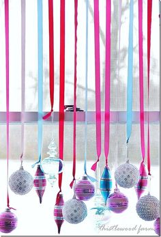 This would be a fun Idea to decorate a retail shop window | christmas ornaments