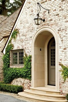 Notice the Details: The Limewash - New House Gets a Makeover - Southernliving. The custom mixture of lime, pigment, and water penetrates the brick facade, rather than forming a layer over it, resulting in a finish that has instant patina and Exterior Paint, Exterior Design, Brick Exterior Makeover, Modern Exterior, Garage Exterior, Cottage Exterior, Whitewashing Exterior Brick, Exterior Colors, Rustic Brick House Exterior