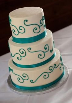 Turquoise wedding cake. Maybe w/purple and with ...
