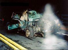 Guardian Angel or Ghost? This picture was at the scene of a horrible accident very shortly after the crash. Some say that this is an angel. The passengers survived. From the looks of the wreckage, an angel would have definitely been needed. What do you think?