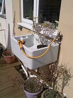 Our old ceramic sink- reused as a handy outdoor plant pot washing sink.
