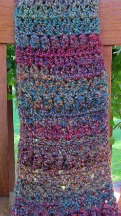 """Crochet Bobble Scarf, Purple and Green Tones, Reversible - Handmade. A soft and comfortable scarf with lines of bobbles on both sides, making it completely reversible. The colours vary from tones of green to purple. Size - 52"""" x 8"""" (app. 132 cm x 20 cm) Yarn Manufacturer Washing Instructions - Machine wash and tumble dry. Do not bleach. Do not iron. Machine washable and dryable."""