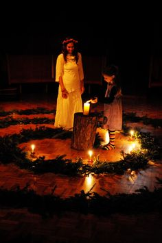 Winter ~ Advent ~ Spiral Garden of Light ~ In this reverent and beautiful ceremony of light, children are led by an angel along a spiral path of evergreens. Reaching the center candle, the children light their apple candles and set them along the spiral path, slowly bringing light into the darkened hall. Songs of the Advent season are sung by a chorus of faculty and grades children.