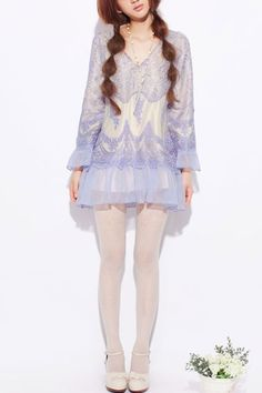 The dress made of chiffon and lace, featuring V-neckline styling, long flare sleeves, flouncing embellishment to hem and cuffs, all over lace design, in regular fit.$107