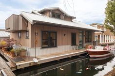 What better way to enjoy views of the Seattle, Washington, coastline than via a houseboat? This contemporary home, anchored off Puget Sound, is larger than its exterior would lead you to believe. Thanks to a smart floor plan, the two-story houseboat features two bedrooms and one bath, and tons of stylish character.