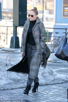 Don't do dressed down: Jennifer Lopez kept her low-key outfit looking stylish with a statement coat and killer heels as she left a studio in New York