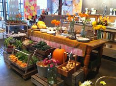 I like the idea of a mini farmers market within a retail shop, like a little general store. Love the big table and the varying levels.