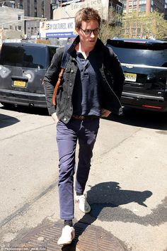 Casual: Eddie Redmayne opted for a relaxed ensemble as he stepped out in New York with wif...