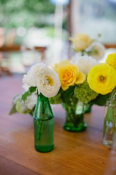 Floral table centerpieces with green bottles - so lovely #diywedding #rustic #vintage #wedding #tablecenterpiece