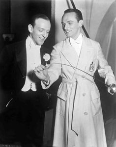 Top Hat 1935  Full BTS shot of Fred Astaire as Jerry Travers standing with Erik Rhodes, who is holding sword.