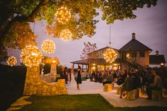 The reception was held outdoors at the Paniolo Ranch in Boerne, Texas. We love the unique hanging orbs of light - so romantic!  Photo byPhilip Thomas Photography Venue:Paniolo Ranch Floral Design byStatue of Design Officiant: Ron Corzine