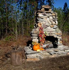 outside rock fireplace; I will do this some day./C wants one sooooo badly!