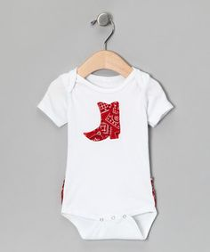Any little buckaroo in this bodysuit will get noticed because of its clever cowgirl appliqué and ruffled rear, but it's the convenient snaps, lap neck and cozy cotton construction that really make this piece so invaluable.