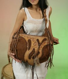 Root of Life. This bag was designed exclusively for Young Artist Exhibition 2009. It contains and reflects kyrgyz national motives and nomadic culture and nature.