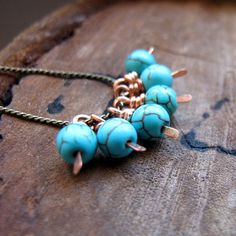 Copper Wire Wrapped Bead Drop dangle. Turquoise Blue Natural Stone. Vintage Style Bead Dangles. $6.50, via Etsy.