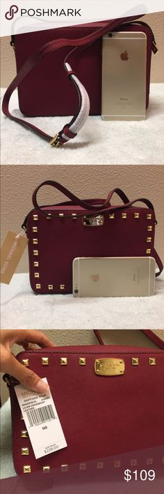 New Michael Kors crossbody big leather camera bag Brand new with tag attached. Never used. Never worn. In a perfect condition. Size is 9.5 x6x2. The strap is adjustable. The color is cherry on the tag. Tag price is $228. The price is firm. Please don't waste your time bargaining. 100% cow leather. Michael Kors Bags Crossbody Bags