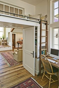 Could we do this over the entry from the kitchen to the dining room? It could become a hideaway nook/loft for reading, and bookshelves below supporting it. There should still be room for the dining room table . . .