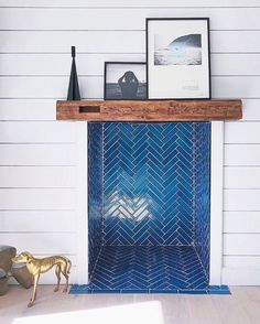 Design inspo: Cool fireplaces to keep you warm this winter. Dark blue herringbone tile in fireplace, stunning fireplace ideas, ways to make your fireplace a statement Wood Burner Fireplace, Fireplace Tile Surround, Fireplace Design, Fireplace Ideas, Tiles For Fireplace, Fireplace Modern, Fireplace Decorations, Fire Surround, Christmas Decorations