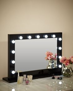 Hollywood Mirror In Black Gloss | Makeup Mirror with Lights | Dressing Table Mirror with Lights | Vanity Mirror with Lights | Illuminated Makeup Mirror | Holllywood Mirror UK | Light Up Makeup Mirror | Hollywood Mirrors | Mirror Size 80 X 110cm |The best illuminated high glossy black makeup mirror on the market which comes with 13 led light bulbs to create the perfect environment to get ready at your dressing table. #hollywoodmirror #makeupmirror #vanitymirror #dressingtable