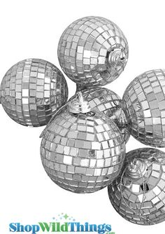 """2"""" Mirrored Disco Balls with an attached string for easy hanging.  Set of 6. Mirrored Disco Ball decoration 2"""" diameter. Real mirrors! Disco balls are a fun way to send little pinpoints of light dancin"""