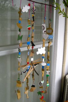 cardboard beads hung from a stick as a mobile