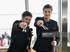 Cellists Stjepan Hauser (L) and Luka Sulic of 2CELLOS visit The Empire State Building on January 22, 2013 in New York City.
