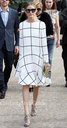 Olivia is working the window pane print trend! She is wearing a white windowpane inspired Chloe long sleeve dress with a pattern Nina Ricci clutch, and print Brian Atwood sandals. Gorgeous dress! She mixes prints/patterns perfectly!