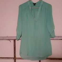 Mint colored blouse sz s Rue 21 Mint color  Size small Has a strip of bling on the front  Few pen marks in pictures 3&4 Personally not noticeable until fully looked over. They are small marks.  Need any additional information just ask. Rue 21 Tops Blouses