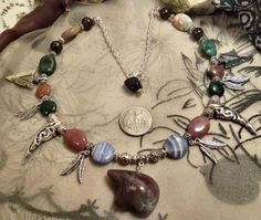Zuni bear agatebronzite and obsidian Totem necklace by GameorGoth, $30.00