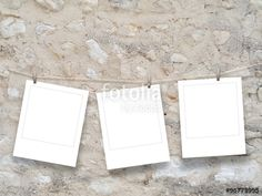 Three square frames hung by clothes pin on brown old stone wall background
