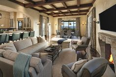 mediterranean-style-living-room-with-open-plan-layout-to-dining-area-and-kitchen