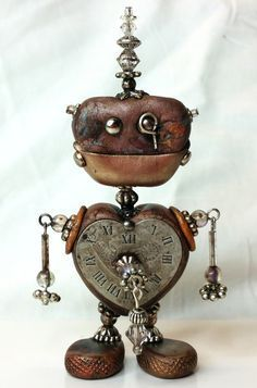 This unique little Steampunk Robot stands about 4 inches tall. He was assembled from polymer clay, bits of metal and Swarovski crystals. No molds
