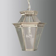 Bevelled glass pendant in antique brass finish