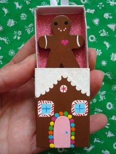 tiny gingerbread man in a tiny matchbox gingerbread house!